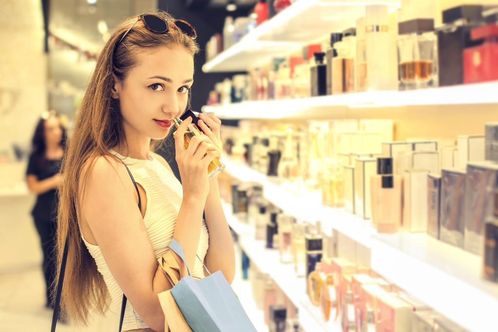 Girl choosing a perfume