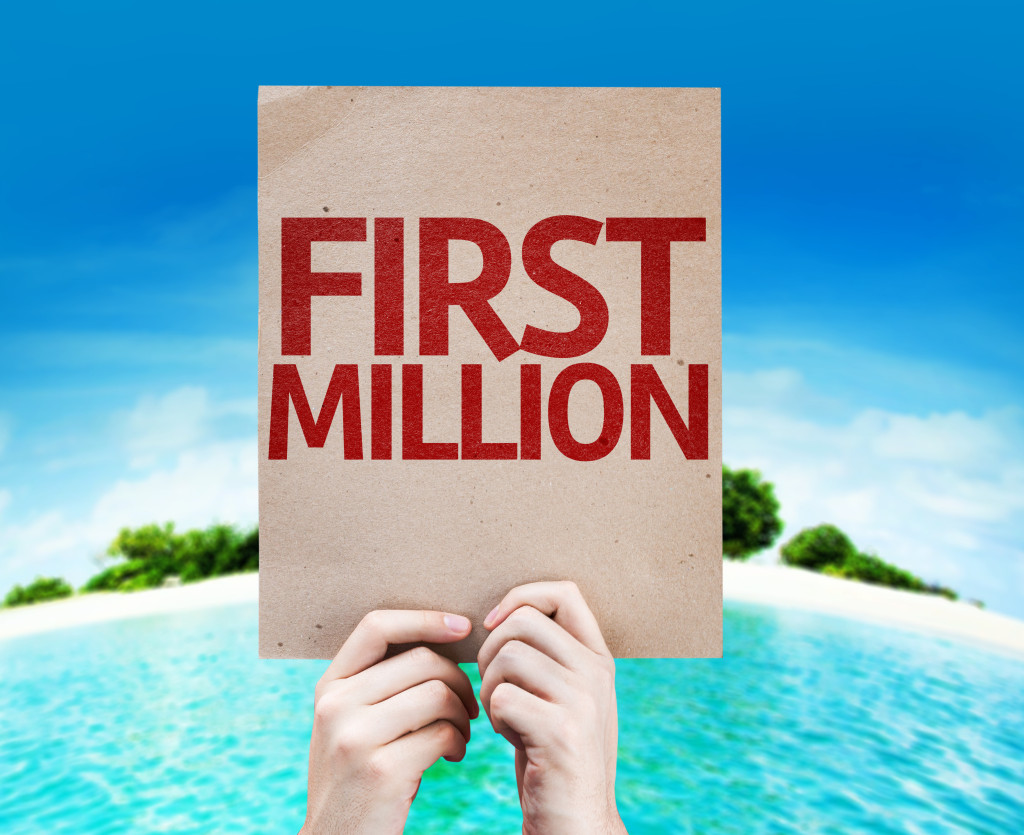 First Million card with a beach on background